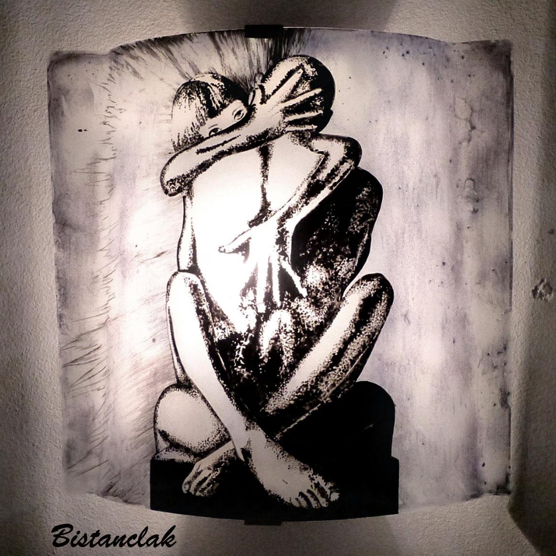 applique murale motif une femme et une homme nus et croisés