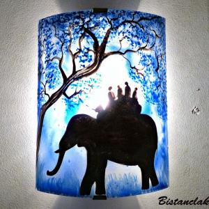 Applique murale bleu motif ballade a dos d elephant création artisanale