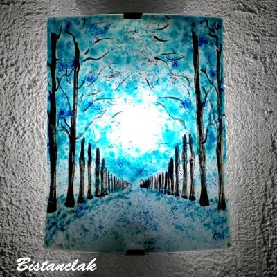 Applique luminaire incurvee motif allee d arbres bleu vendue en ligne sur notr site une creation artisanale francaise