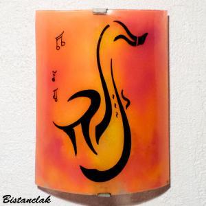 Applique luminaire jaune orange et rouge au dessin d un saxo et de notes de musique vendue en ligne sur notre site