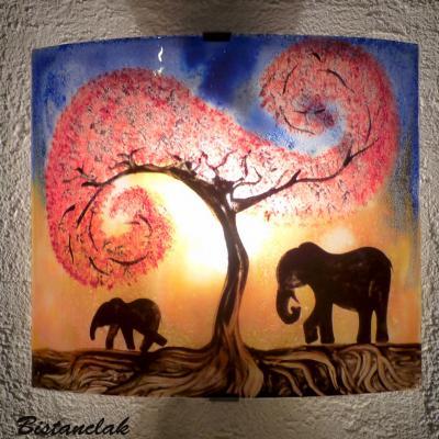 Applique murale décorative bleu et jaune orangé motif la marche des éléphants