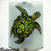 Applique verte motif tortue stylisée