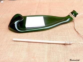 Bouteille recyclee fondue et transformee en bloc notes