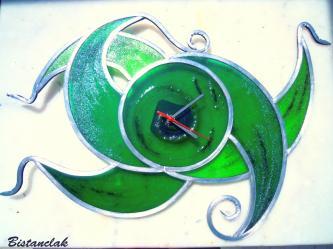 Horloge arabesque verte