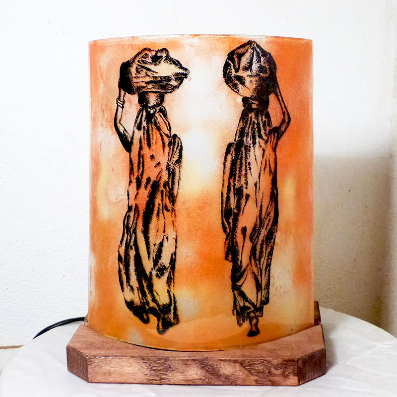 Lampe d'ambiance en verre orange motif les femmes nomades