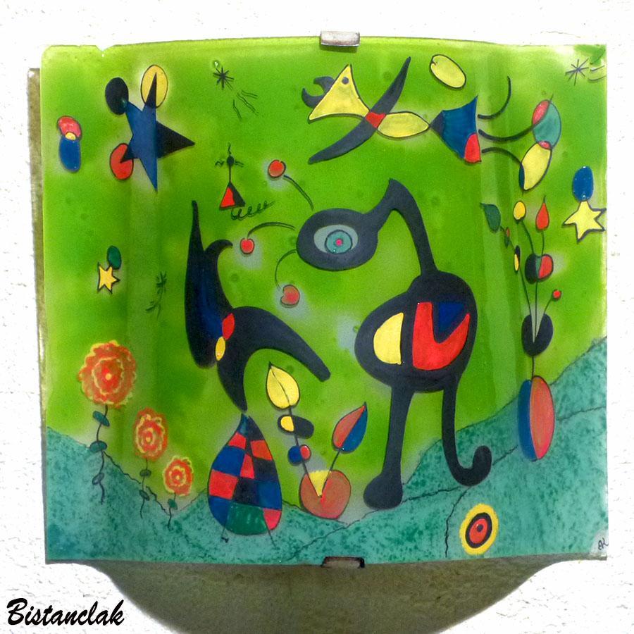 Lampe applique coloree verte motif inspire de miro
