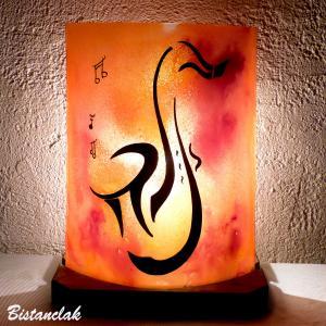 Lampe  de couleur jaune orange rouge au dessin d un saxophone une creation artisanale francaise